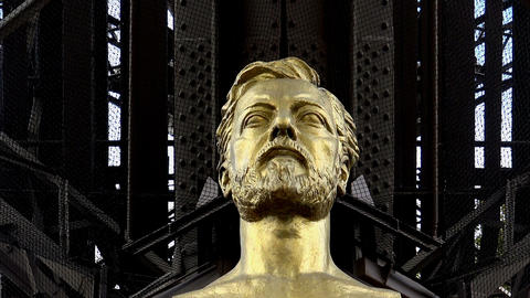 Monument (bust) Alexander Gustave Eiffel at the Eiffel Tower in Paris Live Action