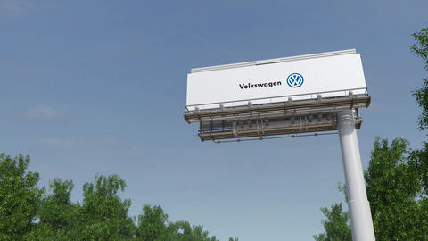 Driving towards advertising billboard with Volkswagen... Stock Video Footage