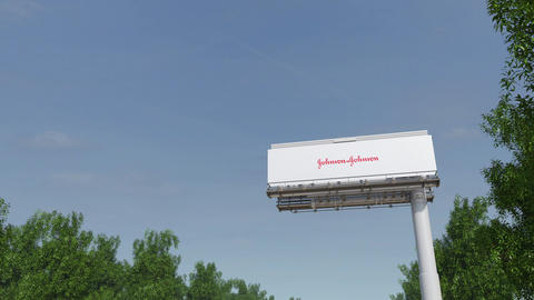 Driving towards advertising billboard with Johnson's logo. Editorial 3D Footage