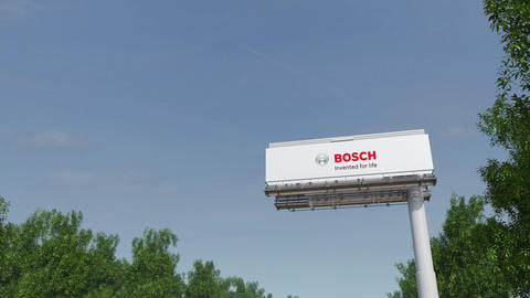 Driving towards advertising billboard with Robert Bosch GmbH logo. Editorial 3D Live Action