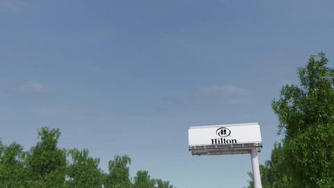 Driving towards advertising billboard with Hilton Hotels... Stock Video Footage
