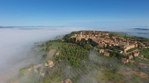 Old Italian city on hill in fog. Aerial Tuscany Footage