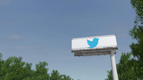 Driving towards advertising billboard with Twitter, Inc. logo. Editorial 3D Live Action