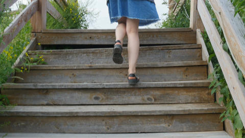 Young girl climbs a staircase Footage