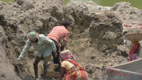 Indian family working as labours Image