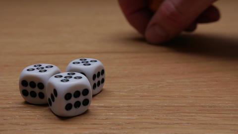 Close up of coins and dices on wooden background Footage