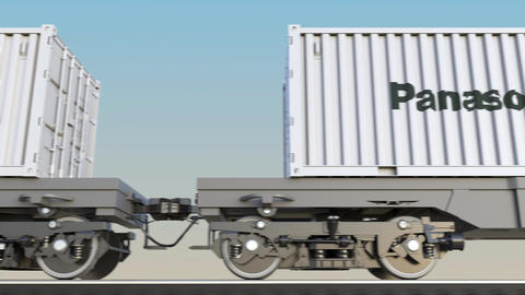 Railway transportation of containers with Panasonic Corporation logo. Editorial Footage