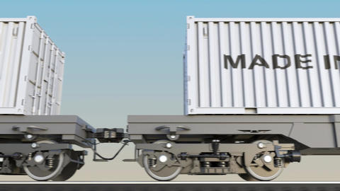 Moving cargo train and containers with MADE IN EU caption Footage