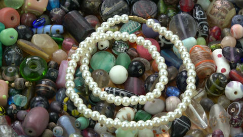 Rotating new luxury pearls necklace on old indian beads Footage