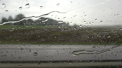 Speed and rain drops background on bus window Footage