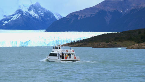 White ship running in front of Perito Moreno Glacier in Argentina Footage