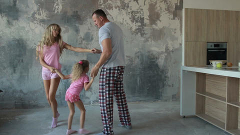 Happy family of three round dance in morning at home Archivo