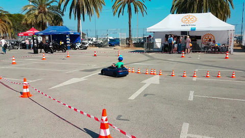 Little Boy Driving Toy Car Image