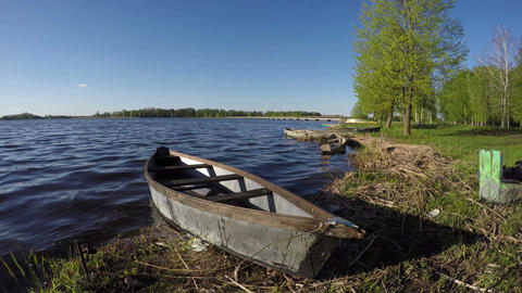 old wooden fishing boats on spring lake water Footage