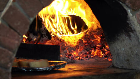 Video of bruschetta in brick oven in real slow motion Footage