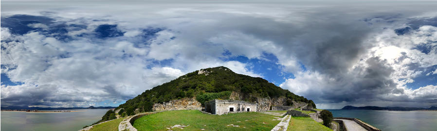 old fort near seacoast, against cloudy sky. Shot in the sunny day. Panoramic Foto