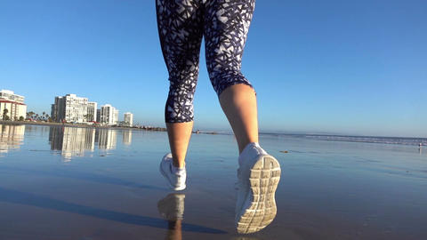 Video of running woman at the beach in real slow motion Footage