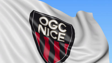 Close-up of waving flag with Nice football club logo, seamless loop, blue Footage
