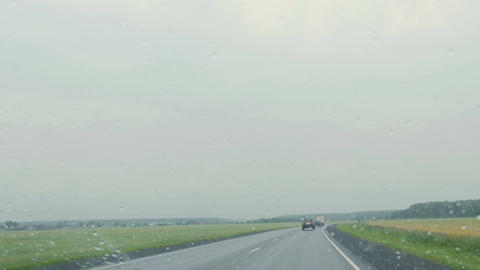 Cars ride on the road in rainy weather Footage