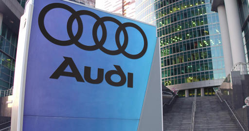 Street signage board with Audi logo. Modern office center skyscraper and stairs Footage