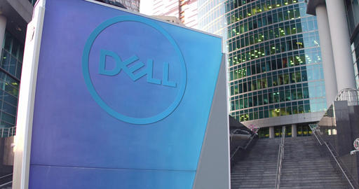 Street signage board with Dell Inc. logo. Modern office center skyscraper and Footage