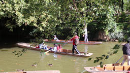 Chinese tourists on Oxford punts boats at Magdalen Bridge Boathouse River Footage