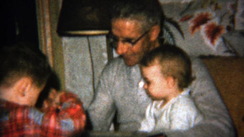 1962: Grandpa feeding baby boy spoonfuls of something delicious Footage