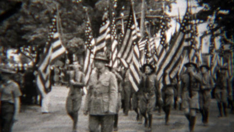 1945: Patriotic USA flag parade down small town mainstreet Footage