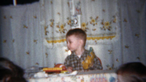 1962: Toddler boy's 1st baseball mit practicing catch with father Footage