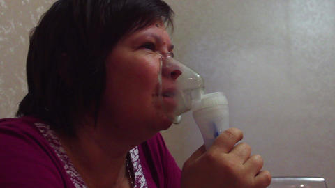 Woman with inhalation mask Footage