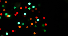 Circular color lamps light on black background in bokeh at movement Footage