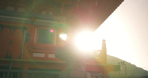 Bright sliding shot of Morning Sun and mountain top temple ライブ動画