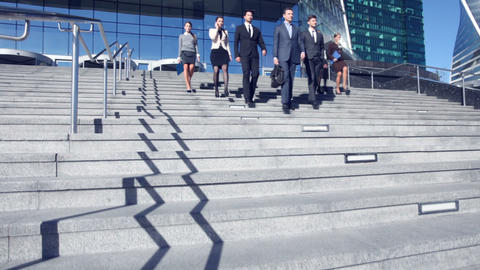 Business people walking down stairs Footage