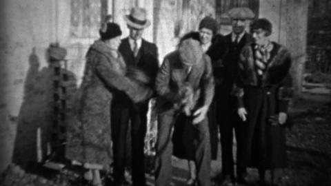 1933: Friends find stray kitten in formal 30's style... Stock Video Footage