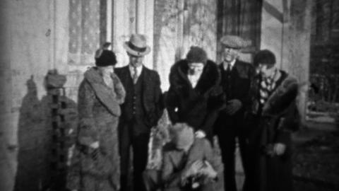 1933: Friends find stray kitten in formal 30's style clothing Footage