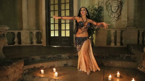 Bellydancer with candles and in beautiful clothes Footage