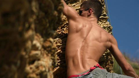 Climber Climbing On A Rock Archivo