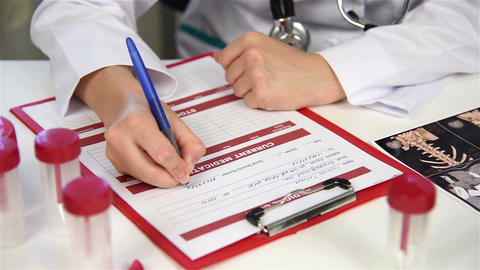 Woman Therapist Filling Medical Form Live-Action