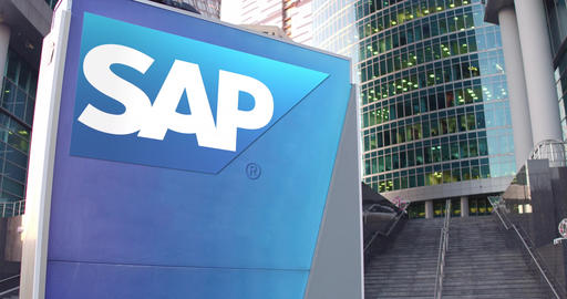 Street signage board with SAP SE logo. Modern office center skyscraper and Footage