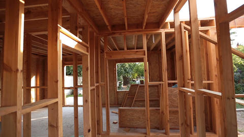 Interior framing of a new house under construction ビデオ