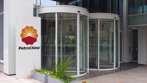 Street signage board with PetroChina logo. Modern office building. Editorial 4K Footage