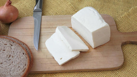 Goat cheese on a wooden cutting board. Proper nutrition. Vitamins. Healthy food Footage