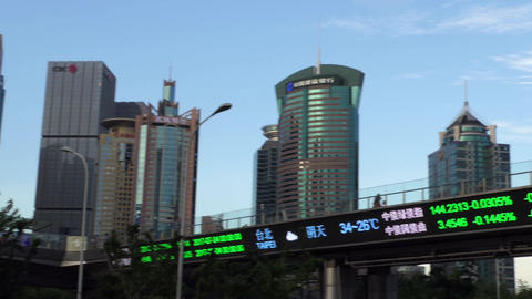 Financial District In Shanghai With Skyscrapers And Stock Exchange News Image