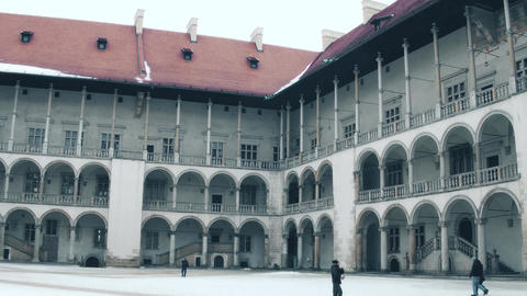 KRAKOW, POLAND - JANUARY, 14, 2017 Pan shot of Renaissance inner courtyard of Footage
