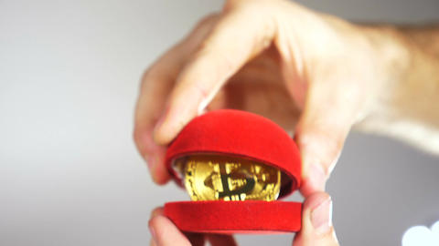 Person Opens Jewellery Case with Model of Currency Bitcoin Footage