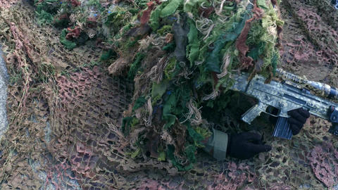 Army sniper wearing disguise camouflage suit at military show Footage