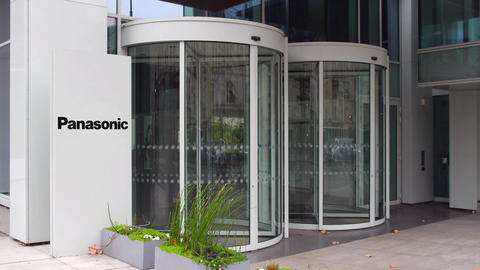 Street signage board with Panasonic Corporation logo. Modern office building ビデオ