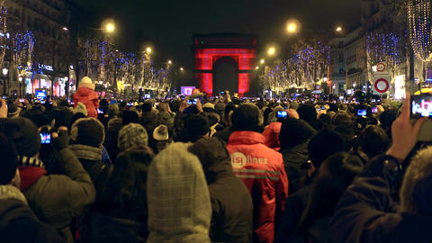 PARIS, FRANCE - DECEMBER, 31, 2016. Crowded Champs-Elysees street and light show Footage