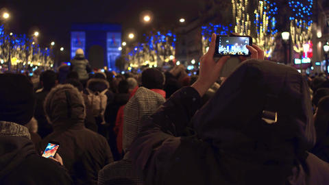 PARIS, FRANCE - DECEMBER, 31, 2016. Tourists making photos of New Year light Footage