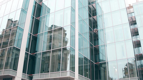 Reflection of old building in modern glass facade of office center in Paris Footage